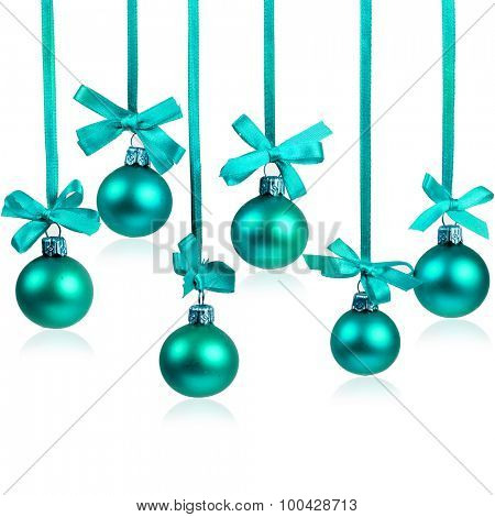 Christmas balls hanging with ribbons on white background