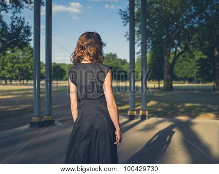 Elegant Young Woman In Park At Sunset