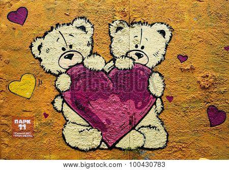 MOSCOW - SEPTEMBER 03, 2015: Graffiti on a urban wall (near Dmitrovskaya Subway Station). Teddy bears and heart