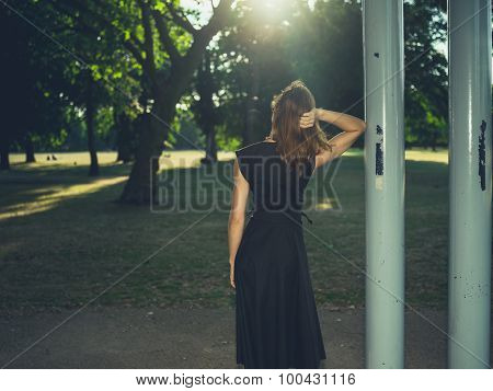 Woman Standing Under Bandstand At Sunset