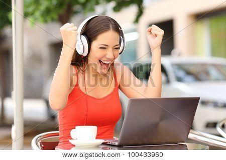 Winner Girl Euphoric Watching A Laptop