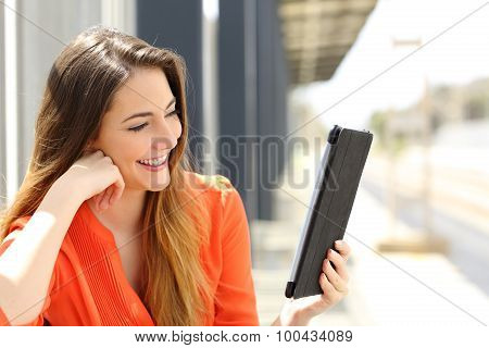 Woman Reading A Tablet Or Ebook In A Train Station