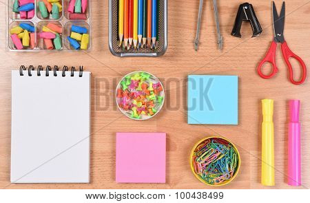 School supplies arranged on a students desk. Closeup overhead view. Back to School concept.