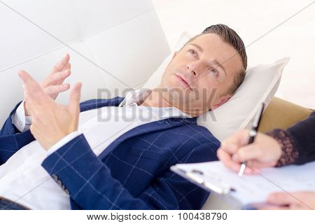 Businessman speaking to a psychologist