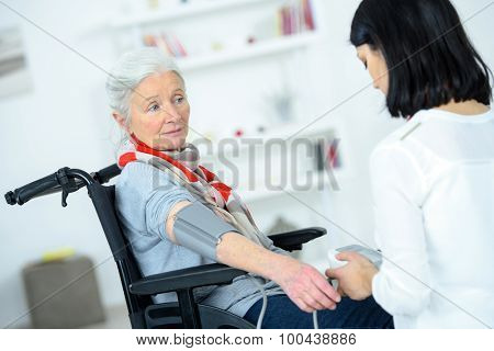 Taking an old lady's blood pressure