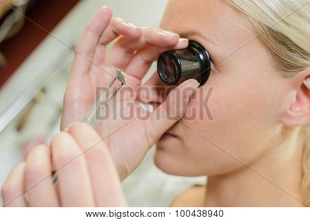 Looking through magnifying eye glass