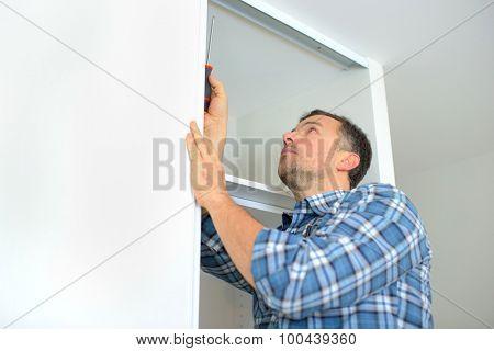 Carpenter installing a wardrobe