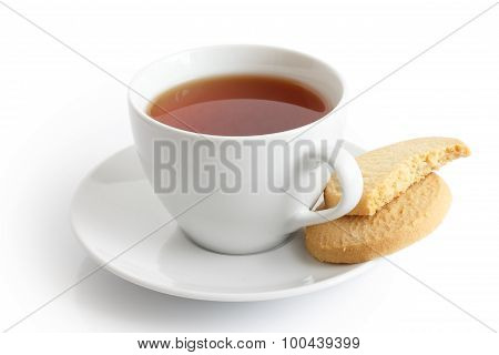 White Ceramic Cup And Saucer With Tea And Shortbread Biscuits. Isolated.
