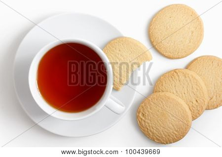 White Cup Of Tea And Saucer With Shortbread Biscuits From Above.