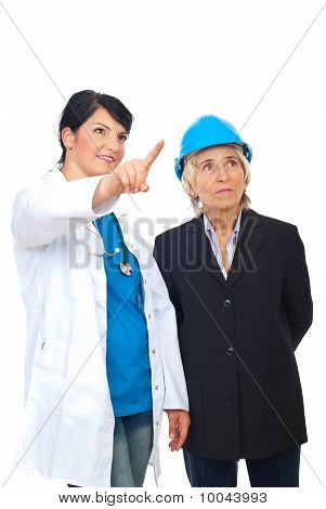 Doctor Showing To Architect Woman