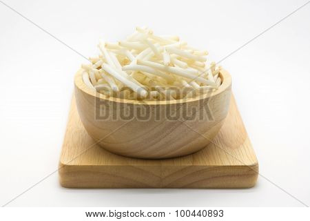 Cutting bean sprouts on wooden plate, white background