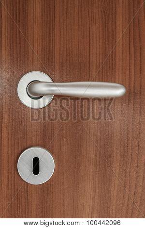 Door handle of plywood