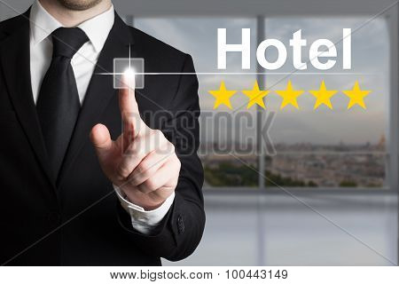 Businessman Pushing Touchscreen Button Hotel Five Star Rating