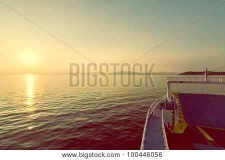 Sunset Over Mountain From Passenger Ship In The Sea