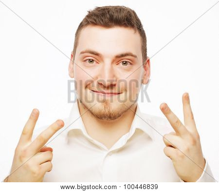 business, success and people concept - business man giving the victory sign on white background