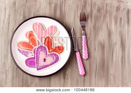 wooden heart object on a plate