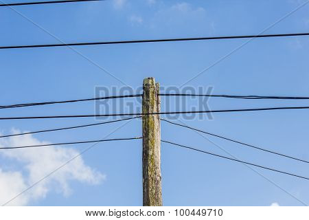 Wood Electric Pole Power Lines And Wires With Blue Sky
