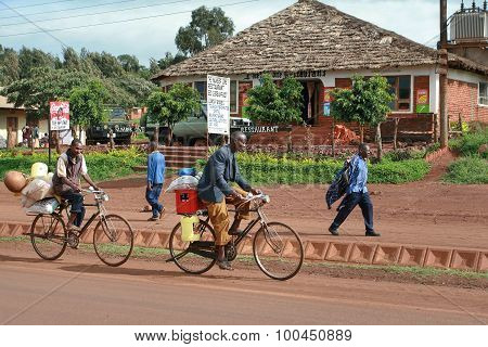 African Peasants Transported Cargo On Road Bikes.