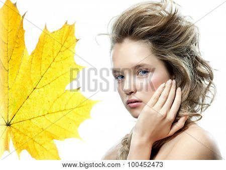 beauty portrait of attractive young caucasian woman blond isolated on white studio shot  face long hair head and shoulders looking at camera autumn yellow maple leaf