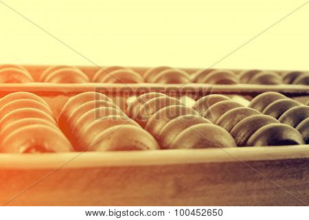 Vintage Style - Close Up Of A Wooden Abacus Beads. Selective Focus, Shallow Depth Of Field. Wooden A
