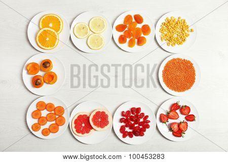 Set of orange products on wooden background