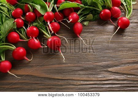 Fresh red radish on wooden background