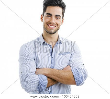 Portrait of happy handsome young man with arms crossed, isolated on white background