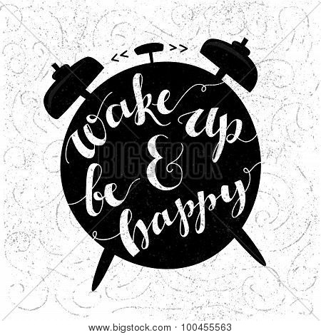 Wake up and be happy. Positive inspirational quote handwritten with modern calligraphy style at blac