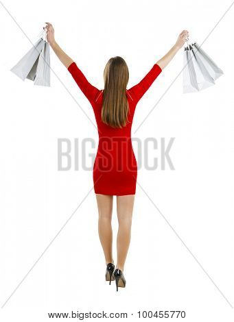 Beautiful and attractive woman holding shopping bags