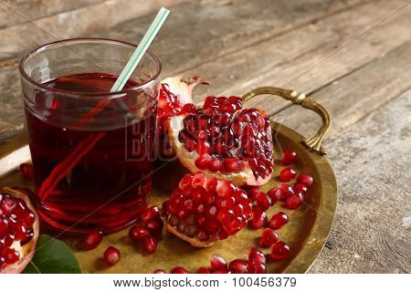 Fresh garnet juice with fruit on table close up