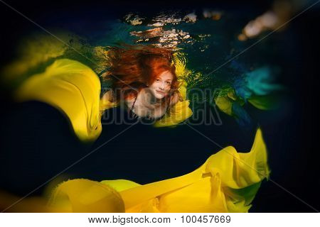 Young Elegant Girl With Red Hair Posing In The Water.