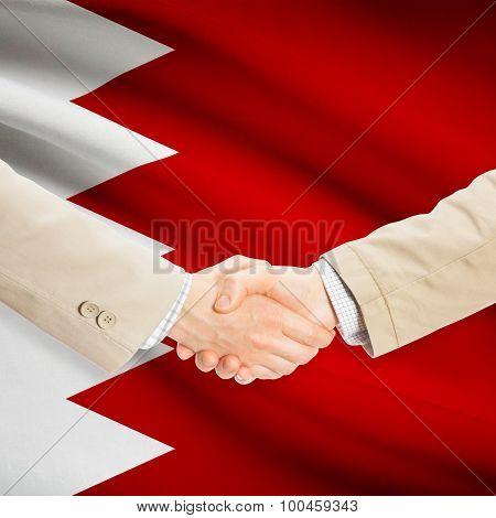 Businessmen Handshake With Flag On Background - Bahrain