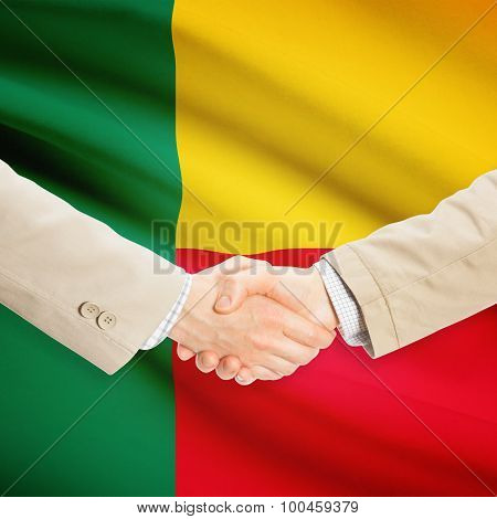 Businessmen Handshake With Flag On Background - Benin