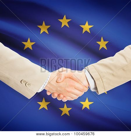 Businessmen Handshake With Flag On Background - Eu - European Union