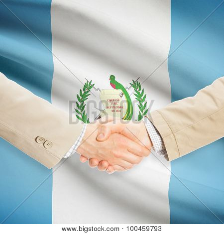 Businessmen Handshake With Flag On Background - Guatemala