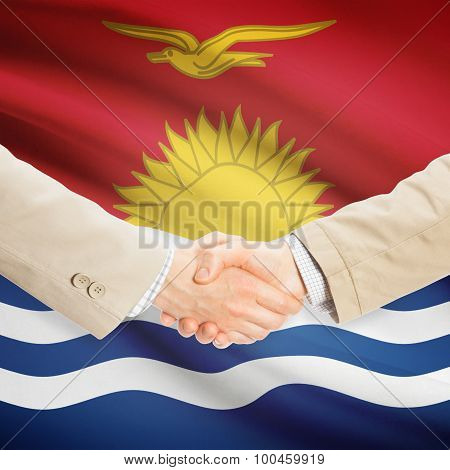 Businessmen Handshake With Flag On Background - Kiribati