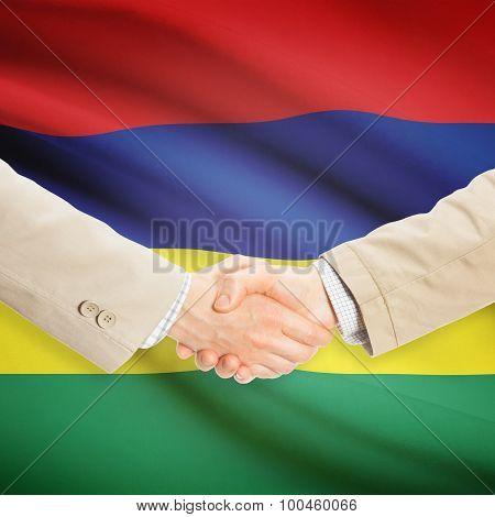 Businessmen Handshake With Flag On Background - Mauritius