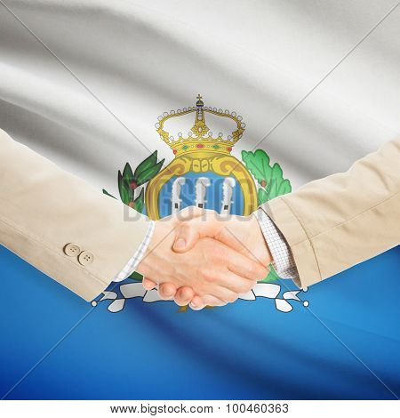 Businessmen Handshake With Flag On Background - San Marino