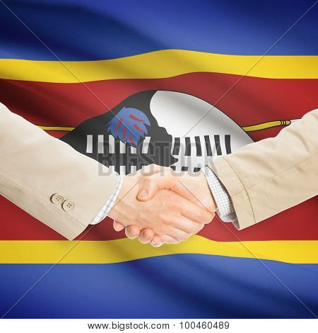 Businessmen Handshake With Flag On Background - Swaziland