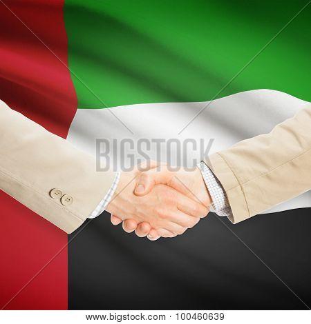 Businessmen Handshake With Flag On Background - United Arab Emirates