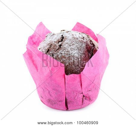 Chocolate cupcake in pink paper isolated on white
