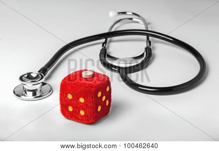 Stethoscope And Dice