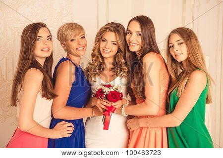 Beautiful And Happy Bride With Her Bridesmaids