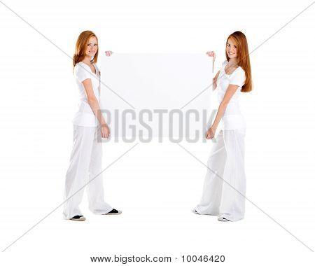 pretty girls holding whiteboard