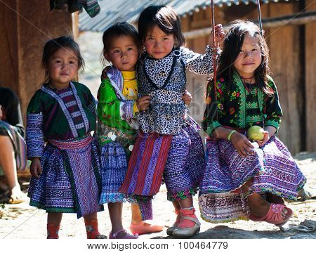 H'mong ethnic little kids in traditional custome in a festival in Mocchau, Vietna
