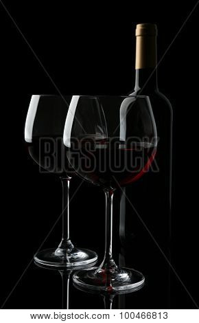 Wineglasses with red wine, isolated on black