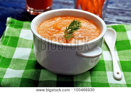 Carrot cream-soup on table close up