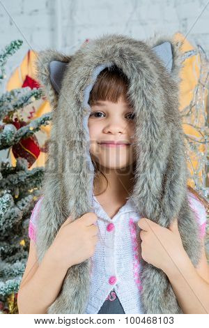 Cute Little Happy Girl Posing In A Fur Hat.
