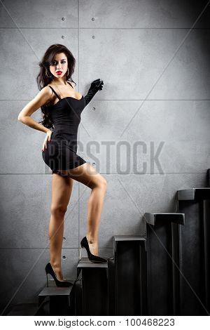 Sexy Brunette Woman Staying On Stairs