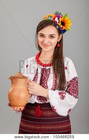 Attractive Woman Wears Ukrainian Is Holding A Jug National Dress